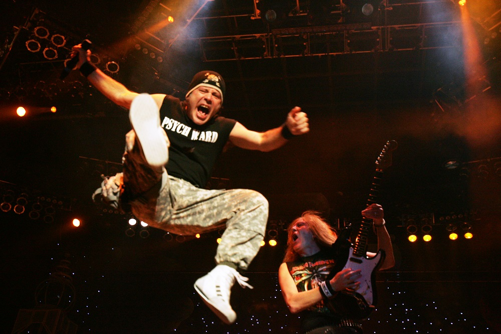 Bruce Dickinson of Iron Maiden leaps on stage at San Manuel Amphitheater in Devore on June 19, 2010 as guitarist Janick Gers plays on. Vanessa Franko/The Press-Enterprise